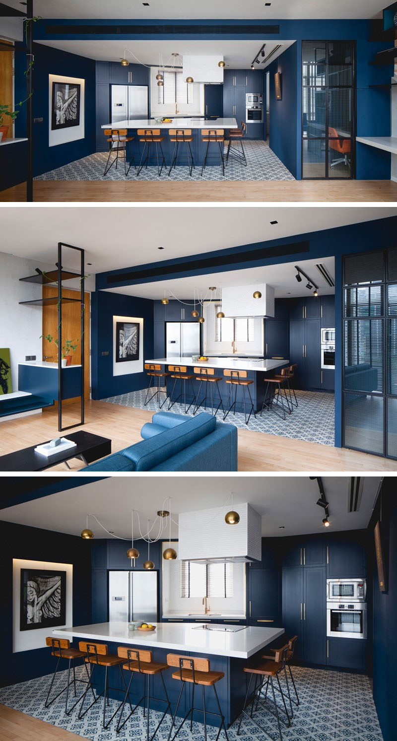 Kitchen Design Ideas - Deep Blue Kitchens // Velvety blue walls and cabinetry with gold features compliment the rest of the blue in the apartment and make the whole space look put together.