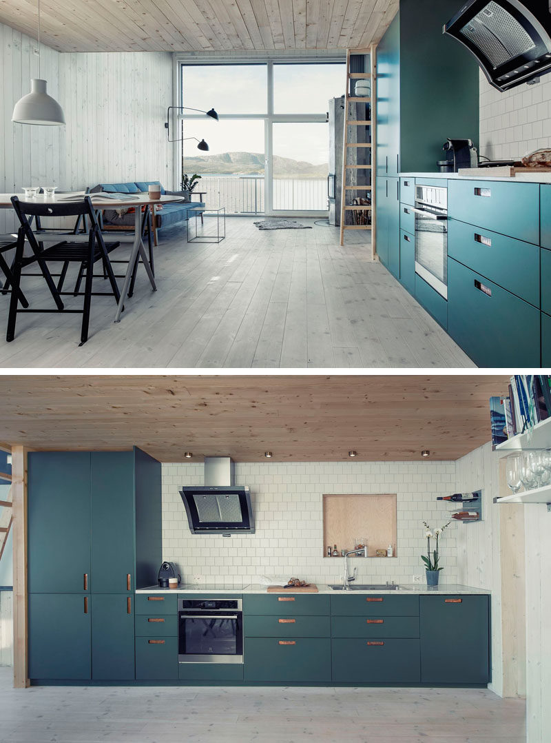 Kitchen Design Ideas - Deep Blue Kitchens // Dark teal cabinets bring color and fun into the light wood interior of this home.