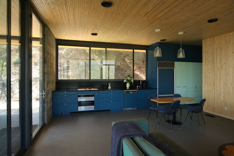Kitchen Design Ideas - Deep Blue Kitchens // Dark and light blue cabinetry add a sophisticated element of fun to the wood and concrete interior of this home.