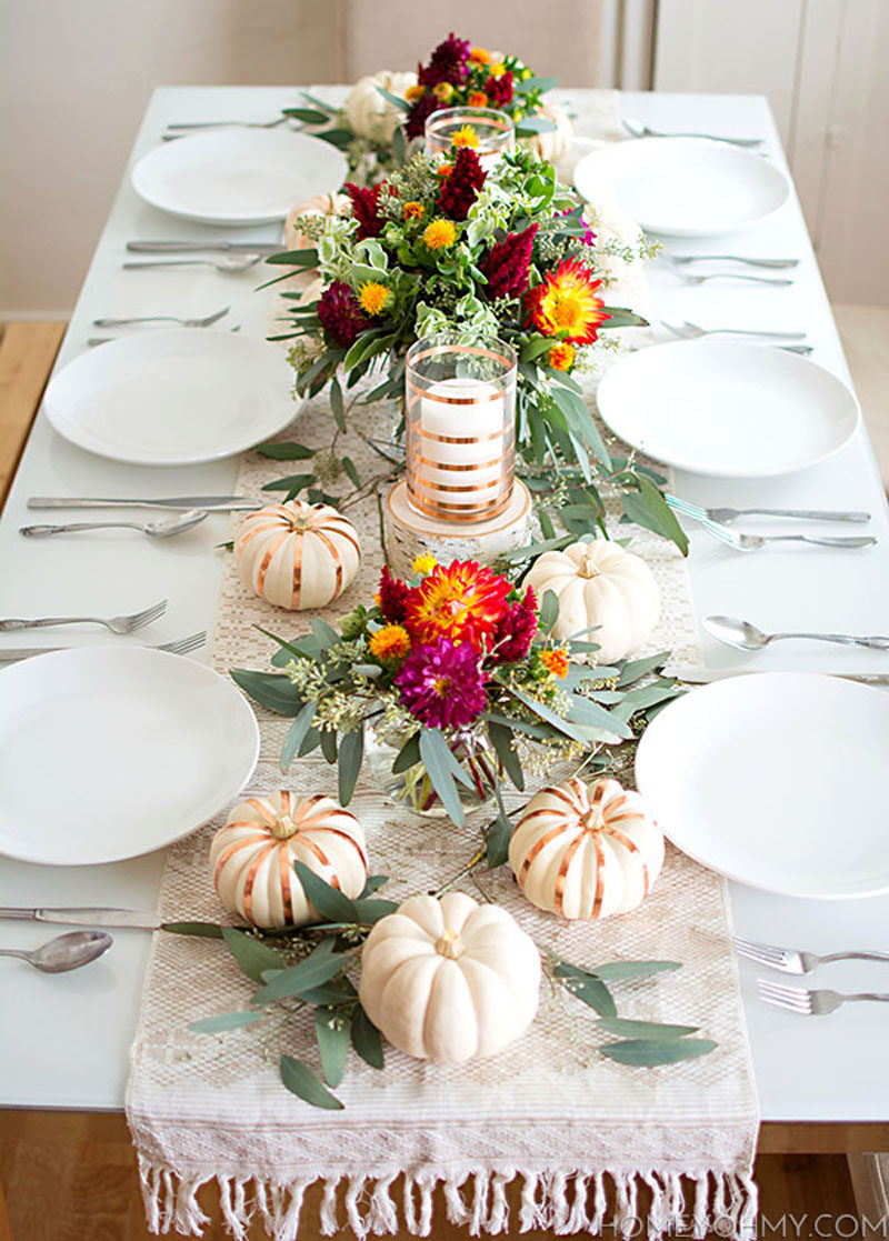 8 Ideas For Bringing Fall Decor Into Your Home // Decorate the table -- Make sure your table is fall ready with pumpkins, leaves, branches, and other elements of nature, as well as lots of candles to create an inviting table reflective of the season.