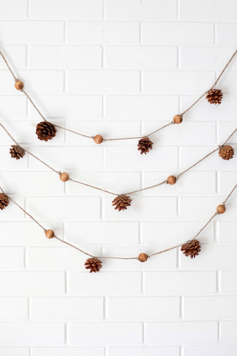 8 Ideas For Bringing Fall Decor Into Your Home // Hang A Garland -- Like wreaths, garlands can be used for decoration all year round as long as they reflect the current season. Elements, like pine cones, wood beads, twine, and dried leaves, are easy to combine and create a textured fall garland.