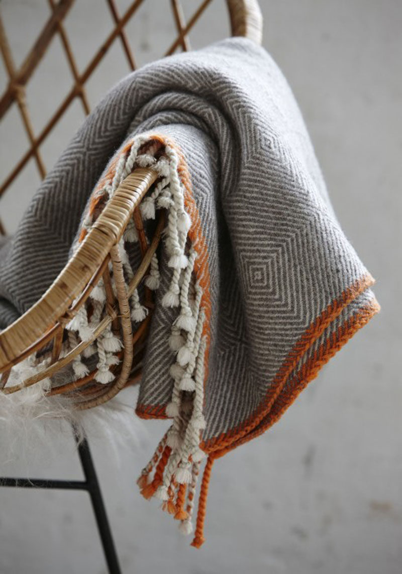 8 Ideas For Bringing Fall Decor Into Your Home // Include Cozy Textiles -- As the weather gets cooler and the days get shorter, cozying up on the couch surrounded by pillows and blankets is one of the best ways to spend an evening.