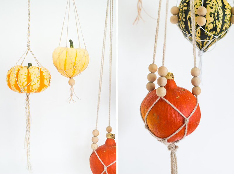 8 Ideas For Bringing Fall Decor Into Your Home // Use Gourds And Pumpkins -- Scattering them along your mantle piece, hanging them from the ceiling, turning them into planters, and positioning them around your front door all add color, texture, and warmth, to your spaces and help your home take on the season.