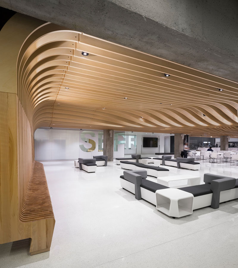 The seat along the wall becomes a dramatic sculptural wood ceiling ...