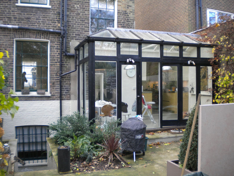 This leaky and cold conservatory was updated with a modern black extension. Click through to see the new extension.