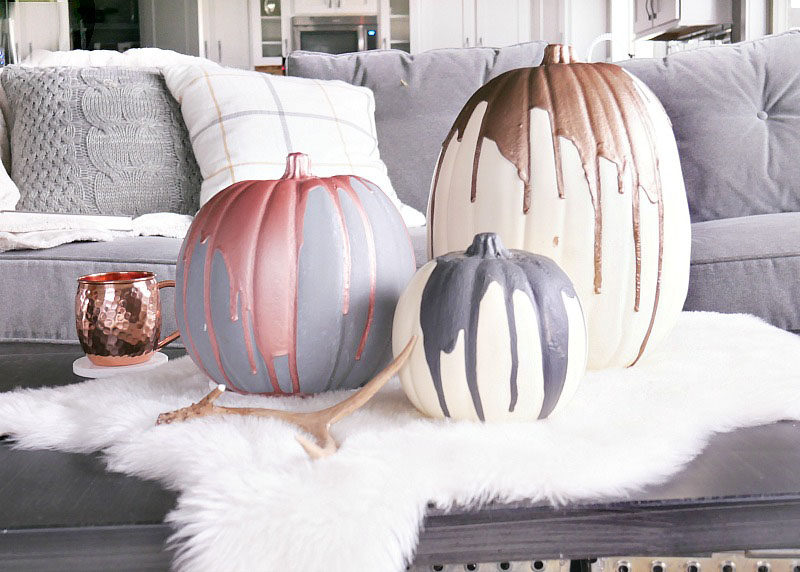 13 Modern DIY Halloween Pumpkin Ideas // A few coats of matte spray paint and some metallic paint are all you'll need to create these modern decorative pumpkins.