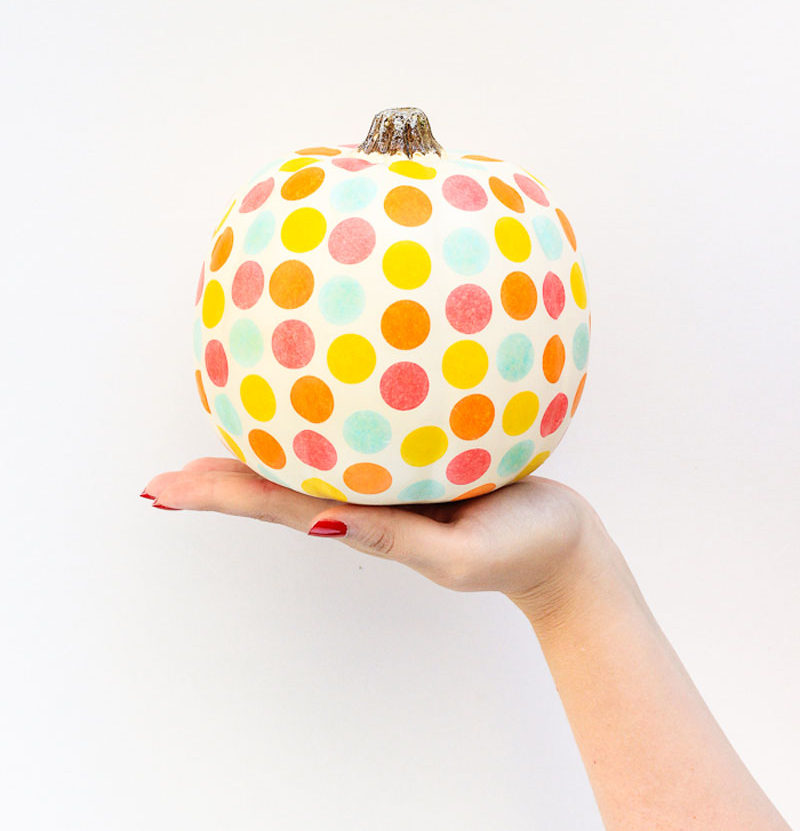 13 Modern DIY Halloween Pumpkin Ideas // To make this fun polka dot pumpkin all you need is tissue paper confetti and glue!
