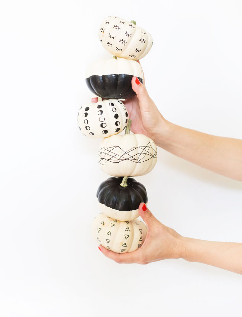 13 Modern DIY Halloween Pumpkin Ideas // Keep your pumpkin decorating super simple with a sharpie and baby pumpkins.