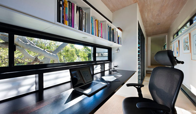 Interior Design Idea - 13 Examples Of Desks In Hallways // A long desk running the length of the window provides a perfect spot to study or work from, and has a nice view to help keep you inspired.