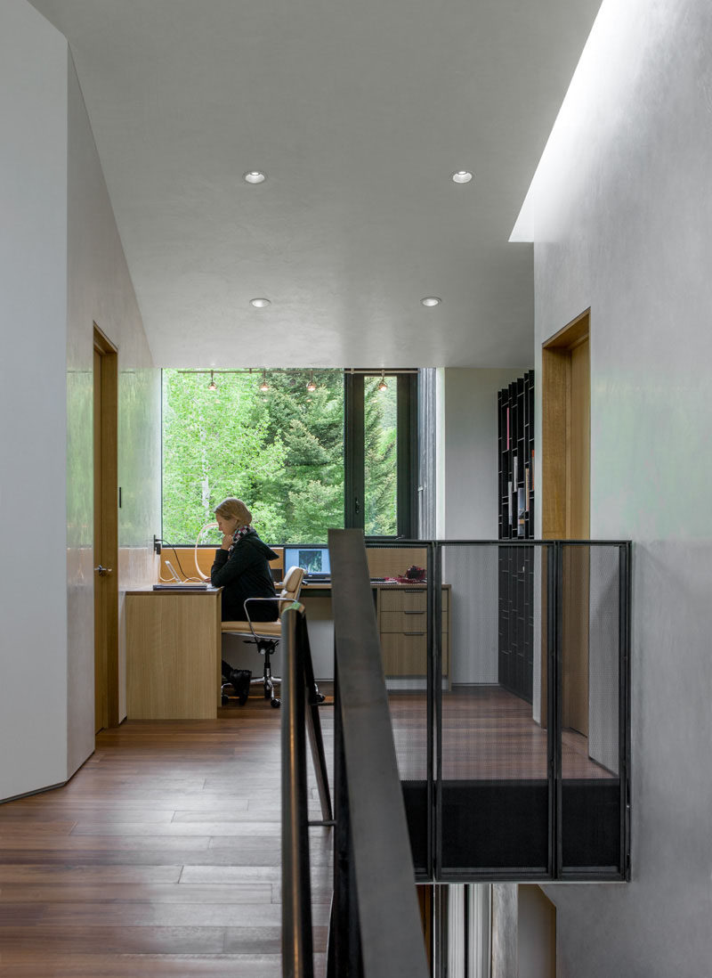 Interior Design Idea - 13 Examples Of Desks In Hallways // This home office sits at the top of the stairs in the hallway between two rooms.