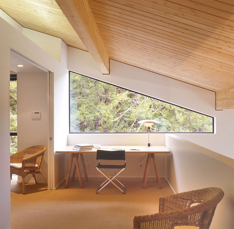 Interior Design Idea - 13 Examples Of Desks In Hallways // This desk has views of the forest outside and looks down to the room below, keeping it connected to what's going on in the rest of the house.