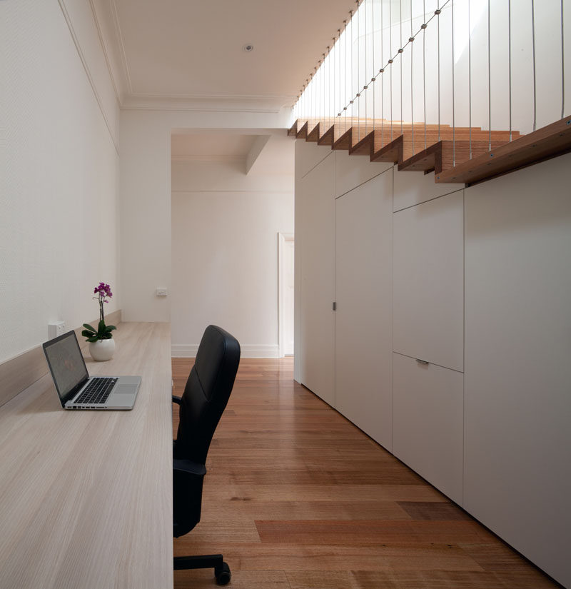 Interior Design Idea - 13 Examples Of Desks In Hallways // This long hallway desk provides a convenient spot to take a break from family life and get some work done.