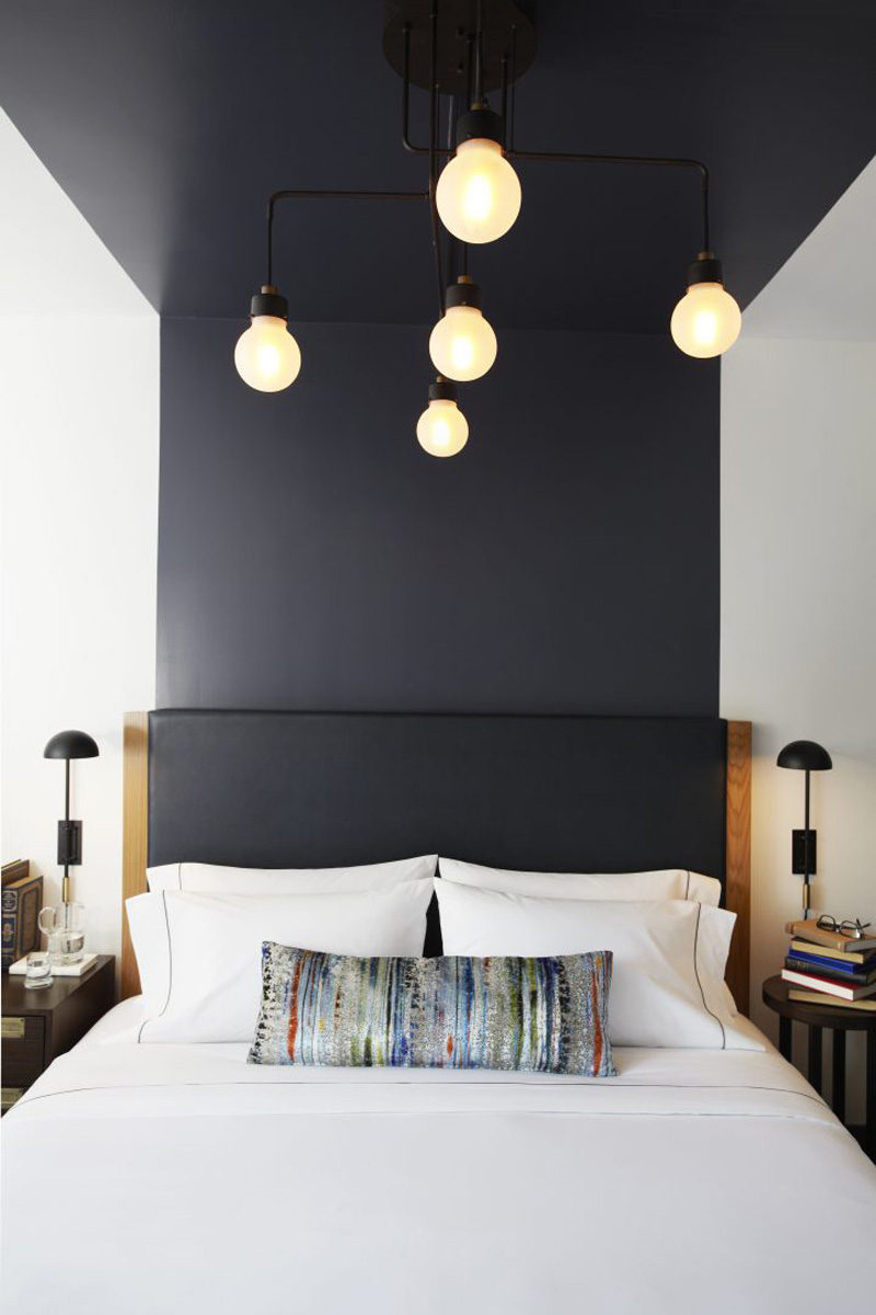 Design Detail - The headboards in this hotel suite are visually extended up the wall and across the ceiling.