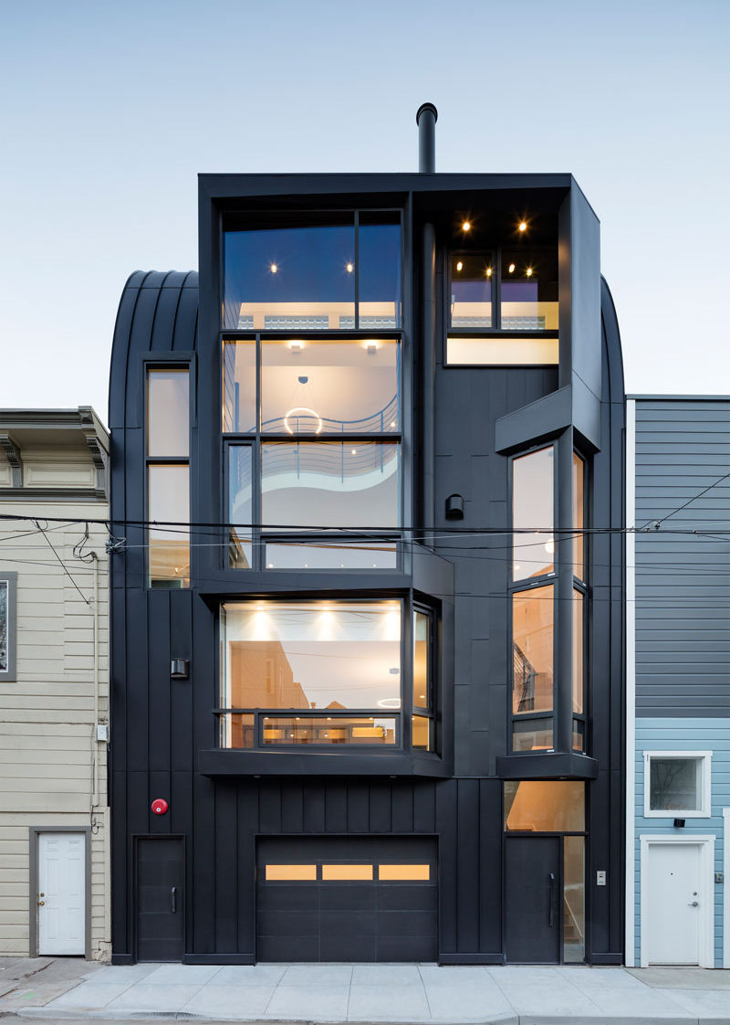 Designed by Stephen Phillips Architects, this black apartment building in San Francisco, is in a mixed-use commercial and residential district, that incorporates an eclectic group of traditional one- to four-story Victorian and Edwardian houses.