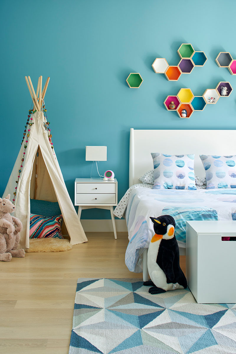 This kids bedroom is full of colour, especially the floating hexagon shelves.