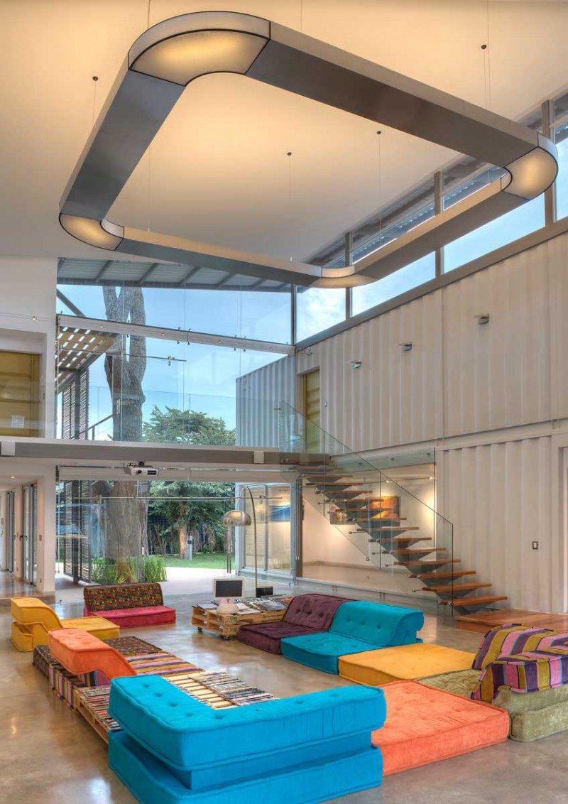 This double-height living room is inside a shipping container home in Costa Rica.