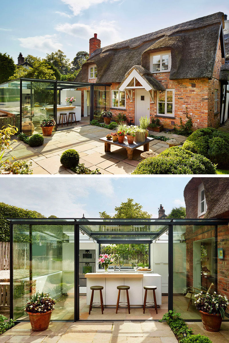 14 Examples Of British Houses With Contemporary Extensions // The thatched roof on this cottage may not be the most modern material, but the glass box extension helps modernize this traditional British home.