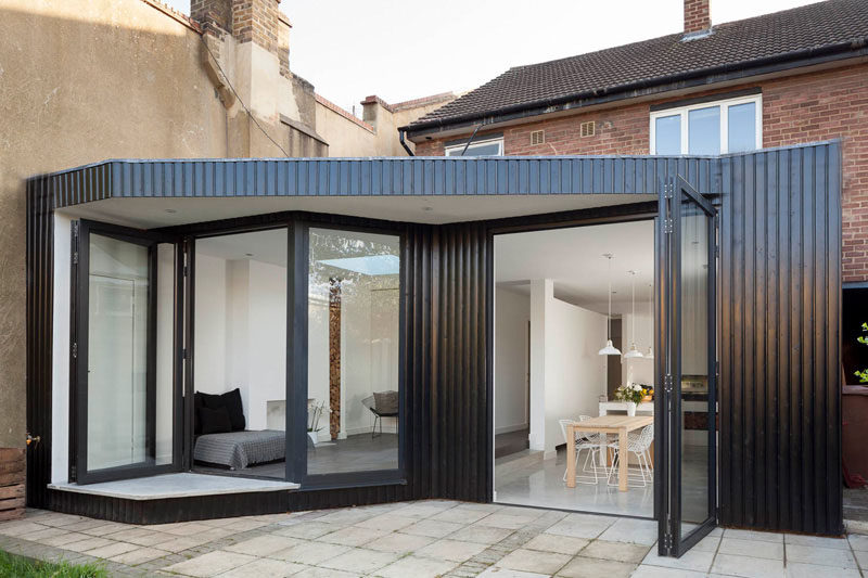 14 Examples Of British Houses With Contemporary Extensions // This London home got a minimalist extension that increased the amount of functional living space and added a modern feel to the brick house.