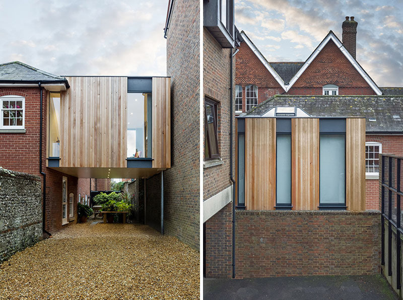 14 Examples Of British Houses With Contemporary Extensions // A floating wood clad box extension on this brick British home created more living space and a covered parking area on the side of house.