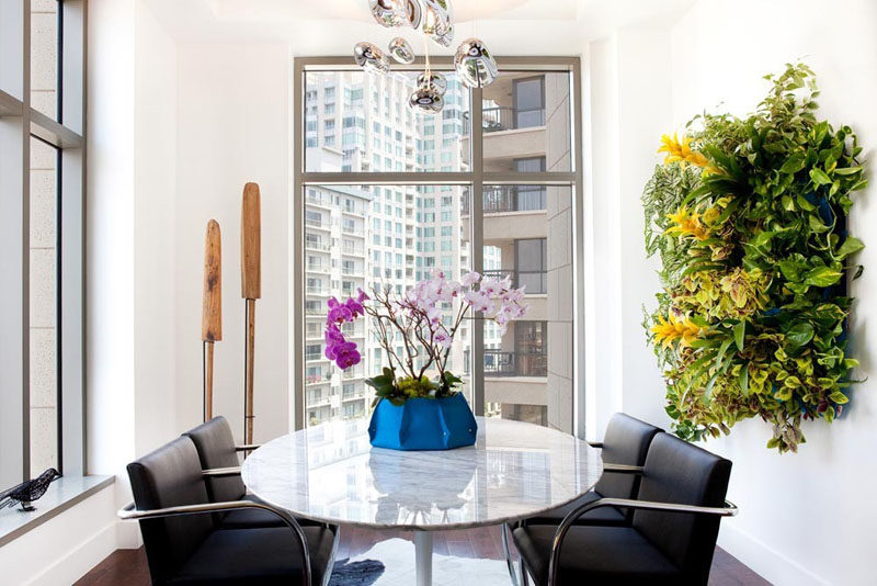 Indoor Garden Ideas - Hang Your Plants From The Ceiling & Walls // A big beautiful installation of plants and flowers on your wall not only gives you a beautiful indoor garden it acts as wall art as well.