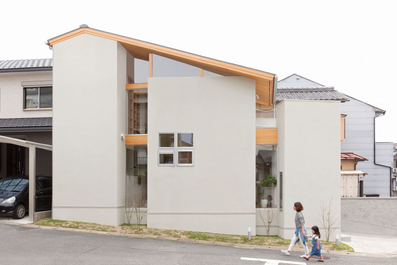 This house in Japan has a built-in, lofted hang-out net for the children to relax in.