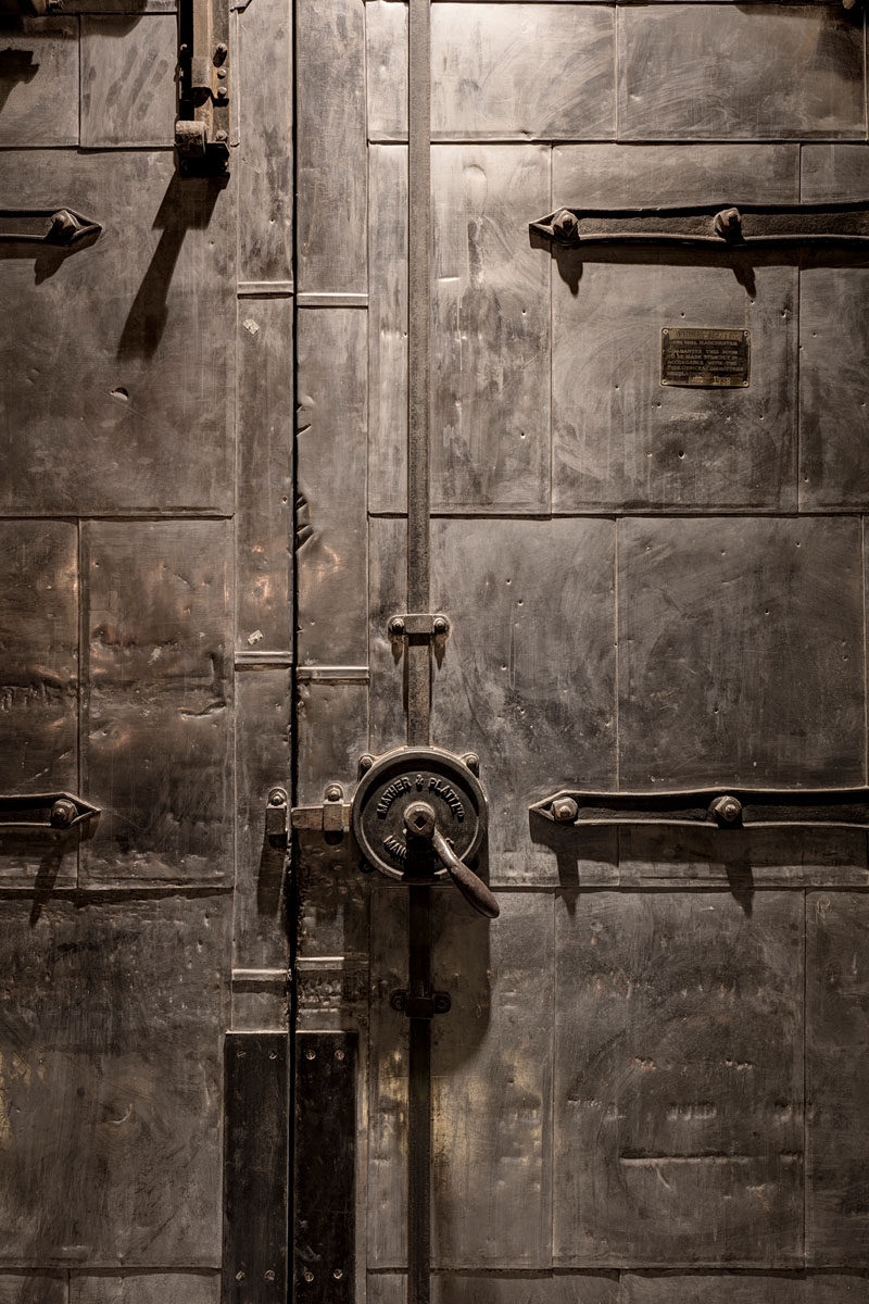 This large metal door is a feature in an industrial apartment in London.
