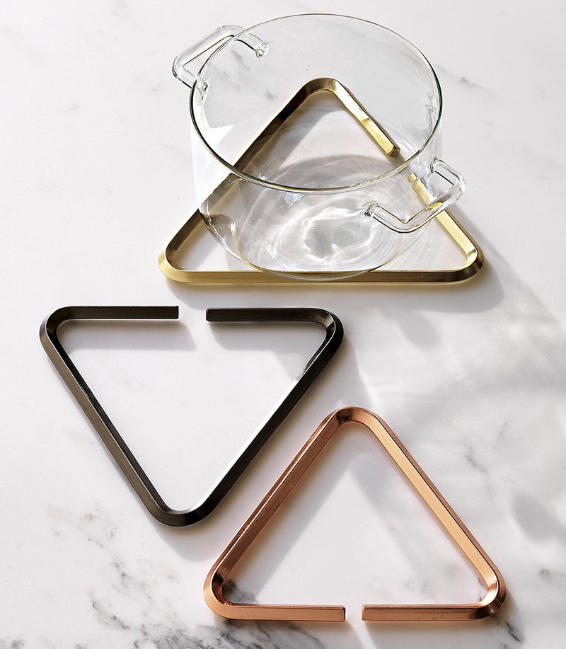 Gift Ideas For People Who Love To Cook // Hot pots, pans, kettles and plates can all be detrimental to countertops and table tops. Protect your surfaces from extreme heat with these metallic triangular trivets.