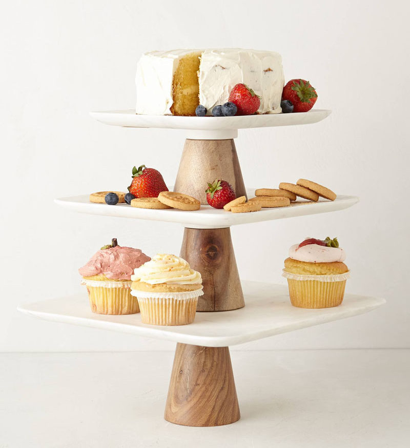 5 Essentials You Need When Hosting An Awesome Modern Tea Party // Serve your snacks on a modern tiered cake stand to make sure your guests can help themselves whenever they like without having to leave the table.