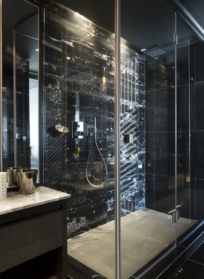 Bathroom Design Idea - 5 Ideas For Adding Marble To Your Bathroom // Shower Surround - This bathroom features black marble for a dramatic effect.
