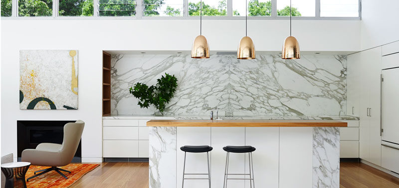 Attractive A Partially Marble Island, Marble Countertops And Backsplash Along The Back  Wall Of This Kitchen Makes For A Clean And Modern Design.