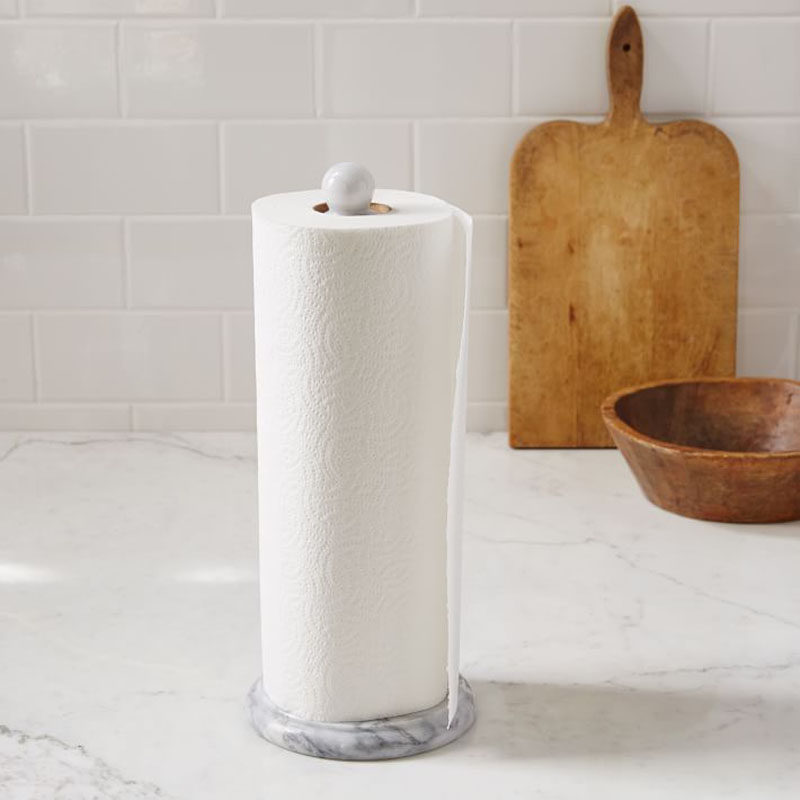 Kitchen Design Idea - How To Add Marble In Your Kitchen // Keep your paper towel rolls feeling like royalty by keeping them on a marble holder.