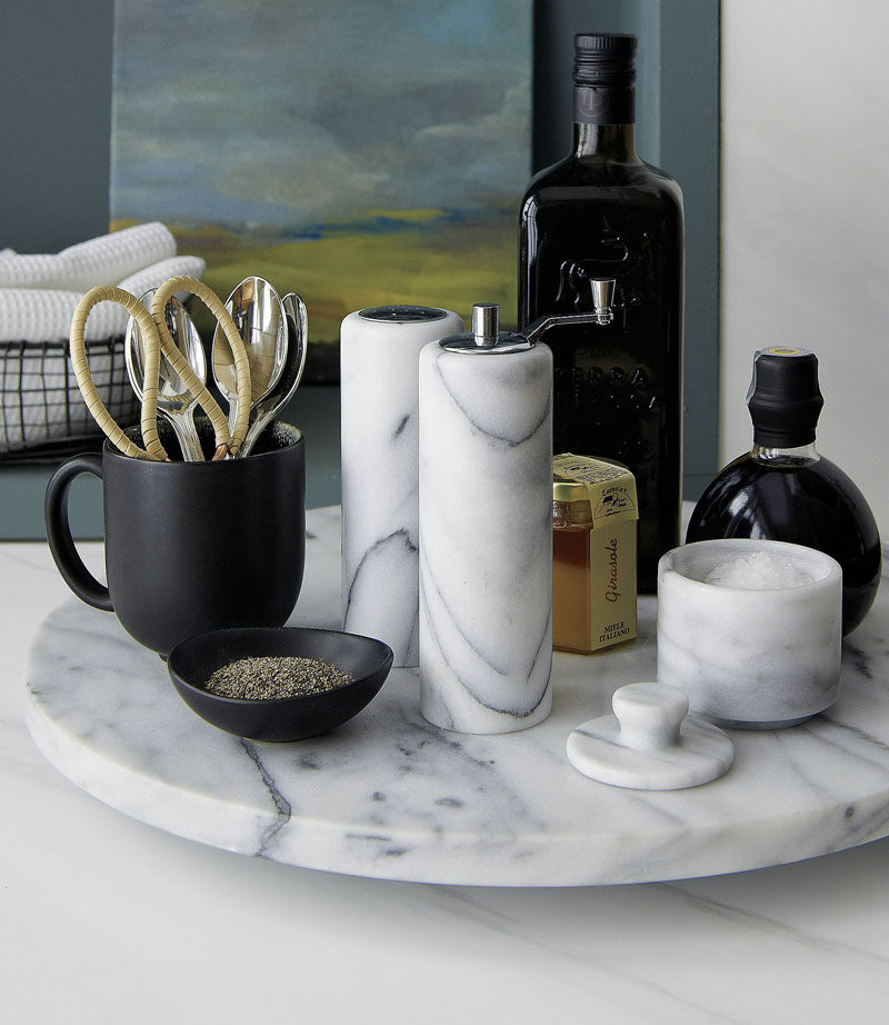 Kitchen Design Idea - How To Add Marble In Your Kitchen // Put your salt and pepper into marble shakers and keep them on a lazy suzan or tray to create the ultimate marble kitchen table centerpiece.