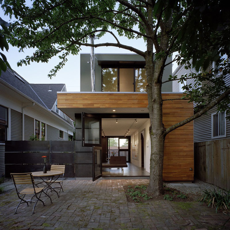 Door Design Ideas - 9 Examples Of Modern Dutch Doors // The doors leading out to the back patio of this home have been divided in half to keep animals and kids inside while still allowing them to see out.