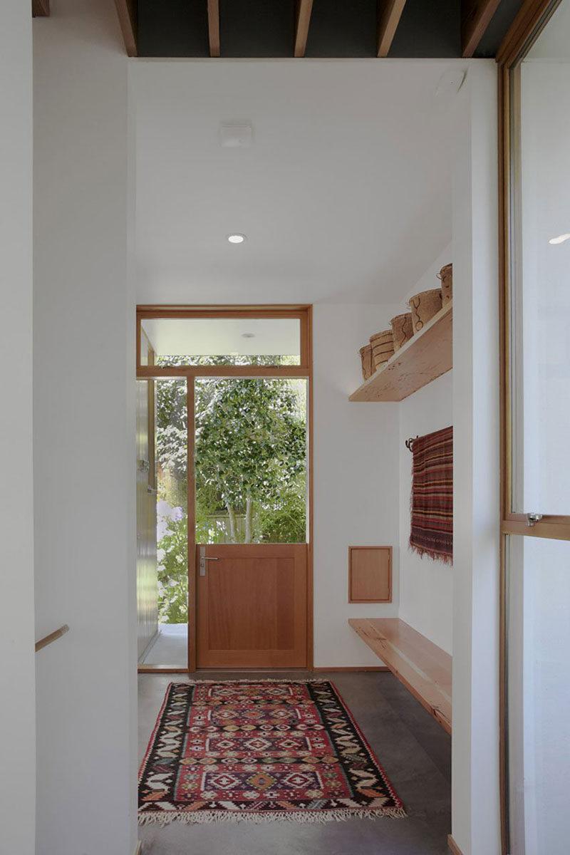Door Design Ideas - 9 Examples Of Modern Dutch Doors // This modern mud room features a Dutch door that lets in a nice breeze when the top half is left open.
