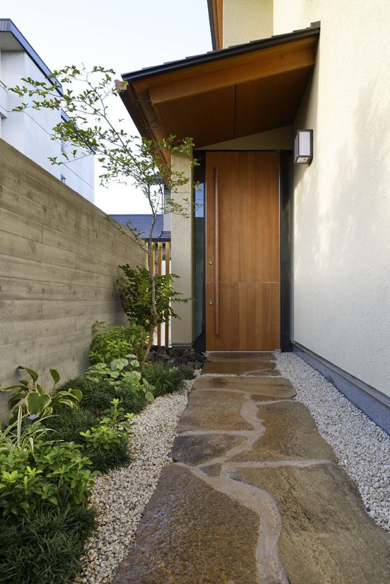 Door Design Ideas - 9 Examples Of Modern Dutch Doors // This tall wood dutch door has a long handle that meets perfectly where the doors divide making it look like a completely solid door.