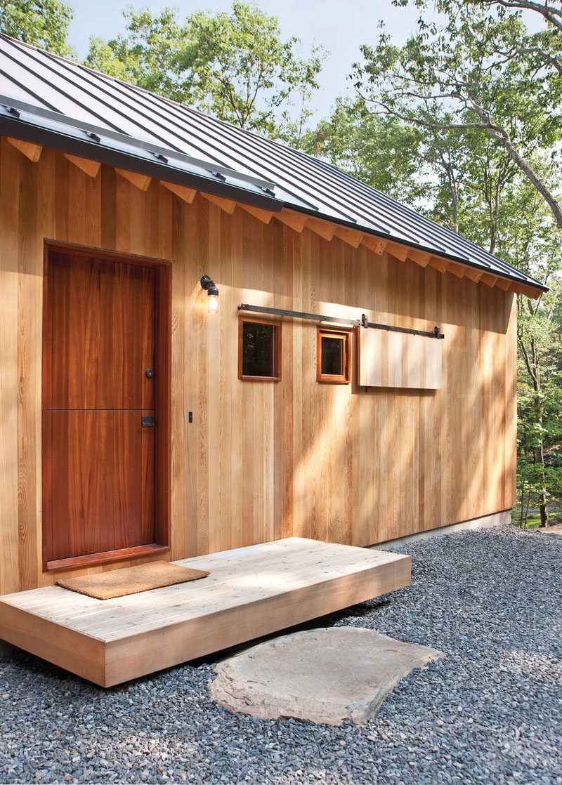 Door Design Ideas - 9 Examples Of Modern Dutch Doors // This dark wood Dutch door is the entrance to the guest house located just off the luxurious main home tucked into the forest.