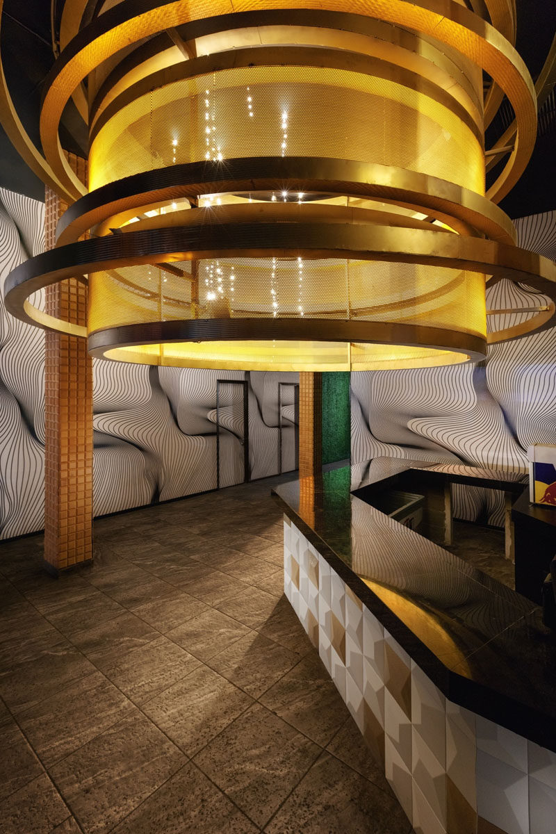 This bar/serving area has a large golden lamp that's almost 10 feet (3m) in diameter.