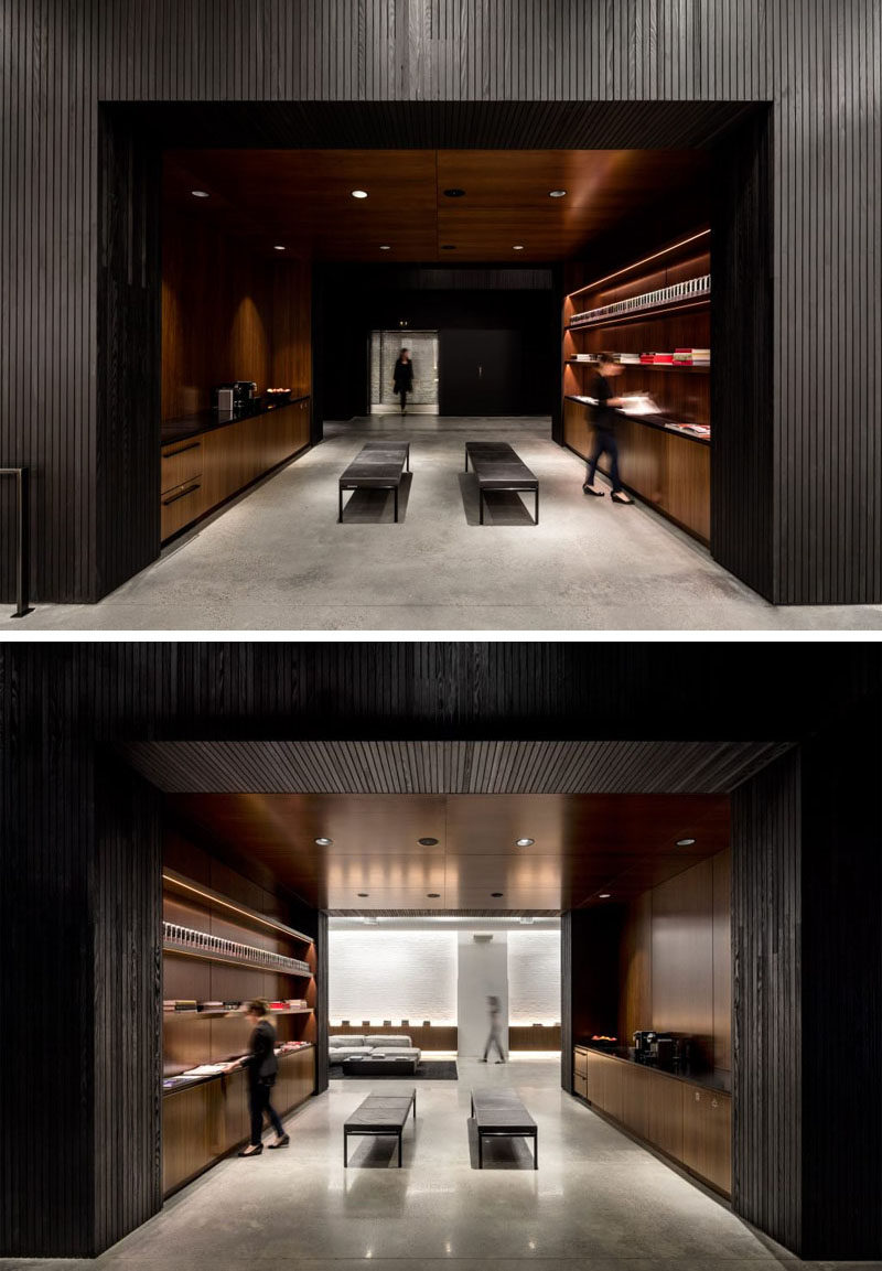 Hidden within a blackened wood wall in this New York office is a self-serve coffee area.