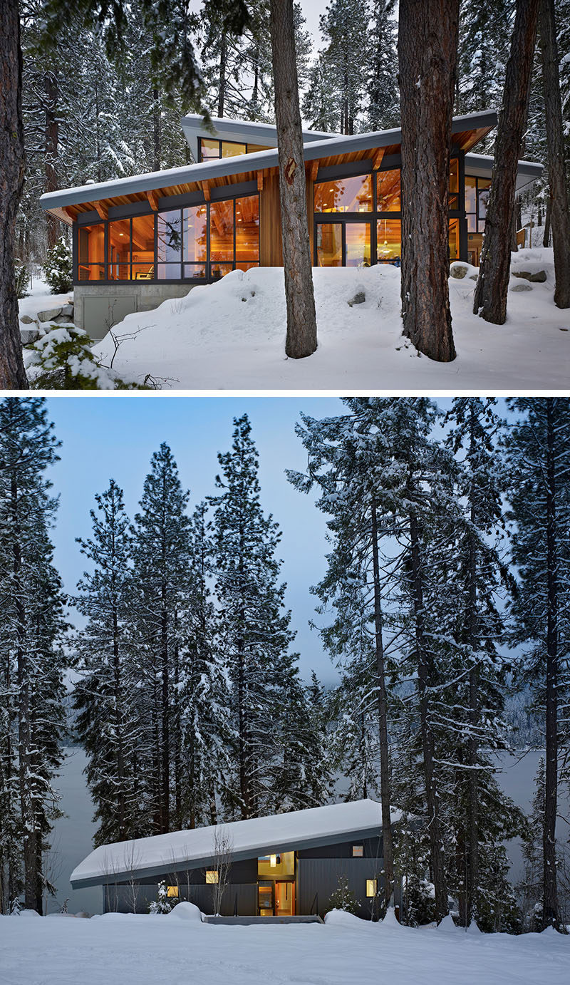 20 Awesome Examples Of Pacific Northwest Architecture // Large windows keep this house feeling connected to the surrounding forest and the rocks surrounding the home provide drainage when the snow melts.