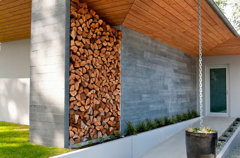 14 Modern Homes That Use Rain Chains To Divert Water // This thick chain sends the rain water into the planter at the base serving to tend to the plant and keep the water from collecting in unwanted places.