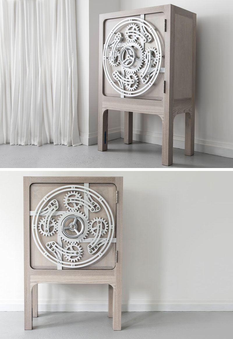 This safe cabinet has a wheel that you turn to open it.