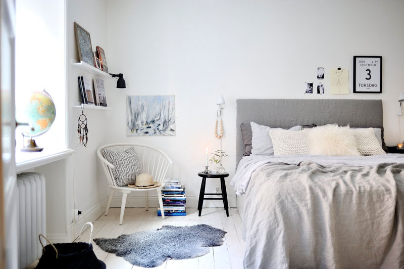 4 Essentials You Need To Create A Scandinavian Bedroom // Textiles -- Chunky knit blankets, wrinkly linen throws, lush carpets, and perfectly fluffed pillows add warmth and comfort to the space but also look beautiful when draped across the end of the bed or piled up at the head of it.