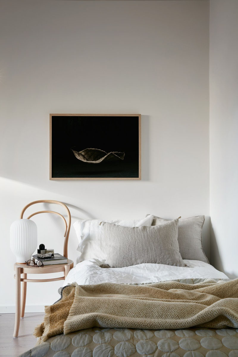 4 Essentials You Need To Create A Scandinavian Bedroom // Furniture -- Night stands in Scandinavian bedrooms are also usually unique in their design or material. Chairs, crates, baskets, or piles of magazines are common finds in Scandinavian bedrooms give the room a minimal yet functional feel.