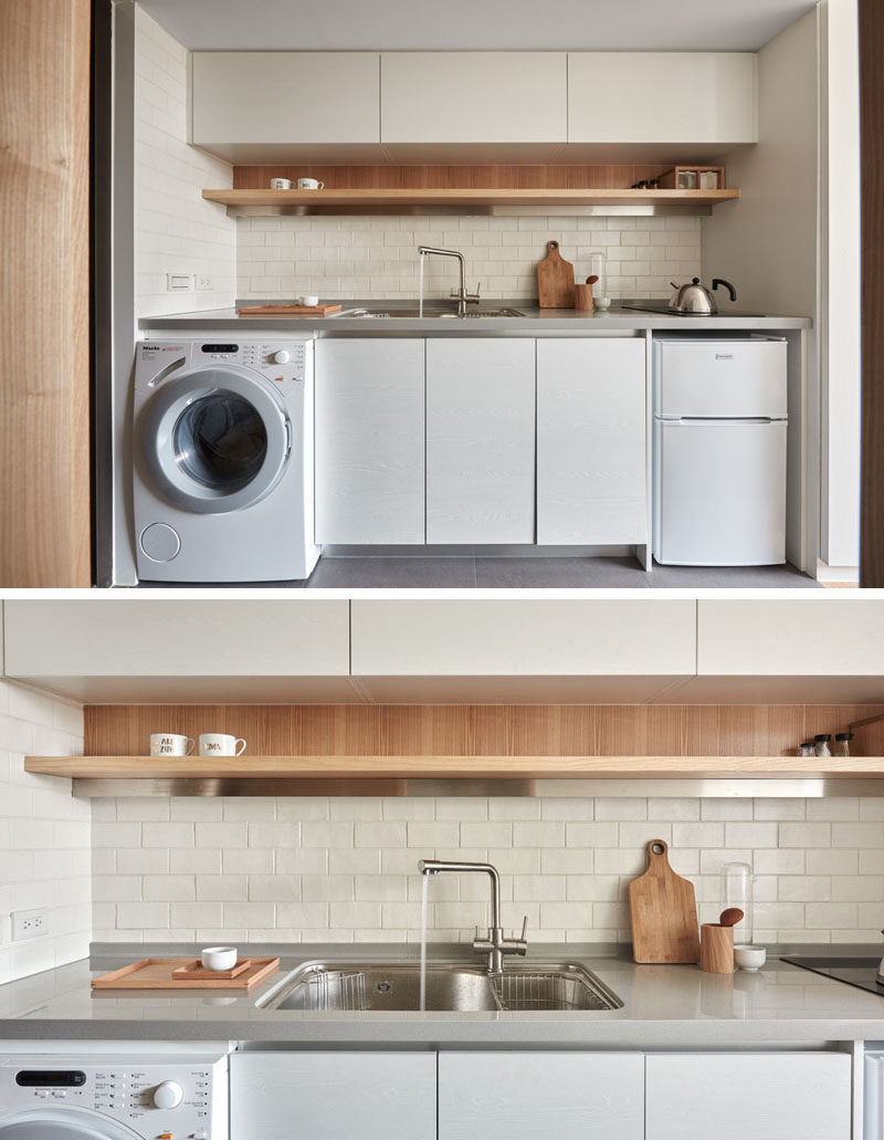 Kitchen Design Ideas - 14 Kitchens That Make The Most Of A Small Space // This small kitchen houses all of the major appliance of the house but is still kept looking clean and bright thanks to all the white used throughout it.