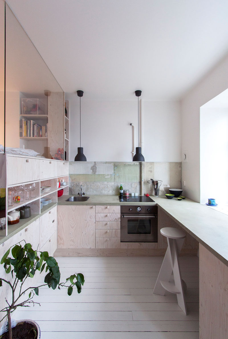 Kitchen Design Ideas - 14 Kitchens That Make The Most Of A Small Space // This small kitchen uses lots of storage and lets in lots of natural light to keep it bright, functional, and easy to navigate. The kitchen counter also doubles as a place to sit and eat.