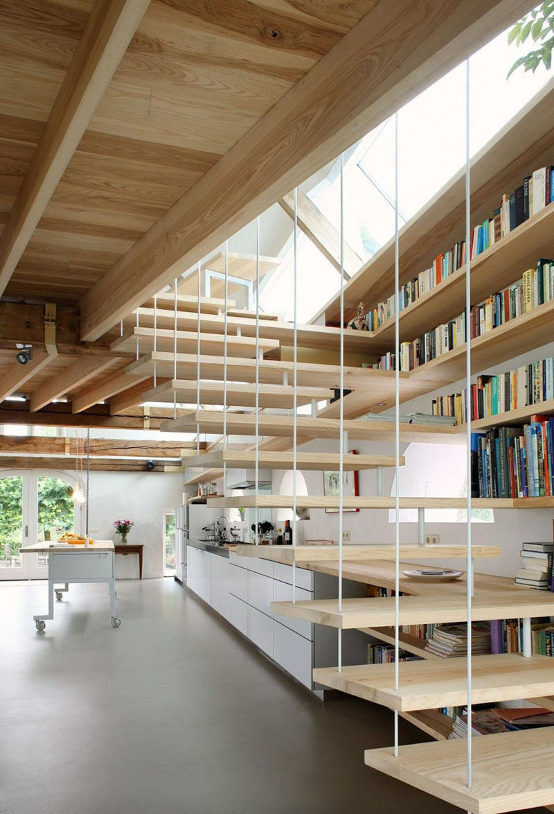 Stairs Design Ideas - 12 Examples Of Staircases With Bookshelves // The shelves that run along side these stairs continue into the kitchen.