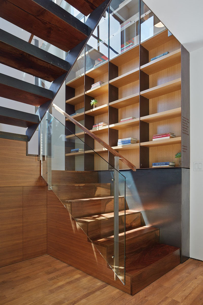 Stairs Design Ideas - 12 Examples Of Staircases With Bookshelves // These stairs and bookcase use a variety of materials including glass, steel and wood.
