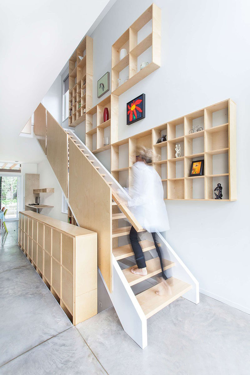 Stairs Design Ideas - 12 Examples Of Staircases With Bookshelves // These plywood shelves that follow the stairs up are a great place to store books and display art or other decorative items.