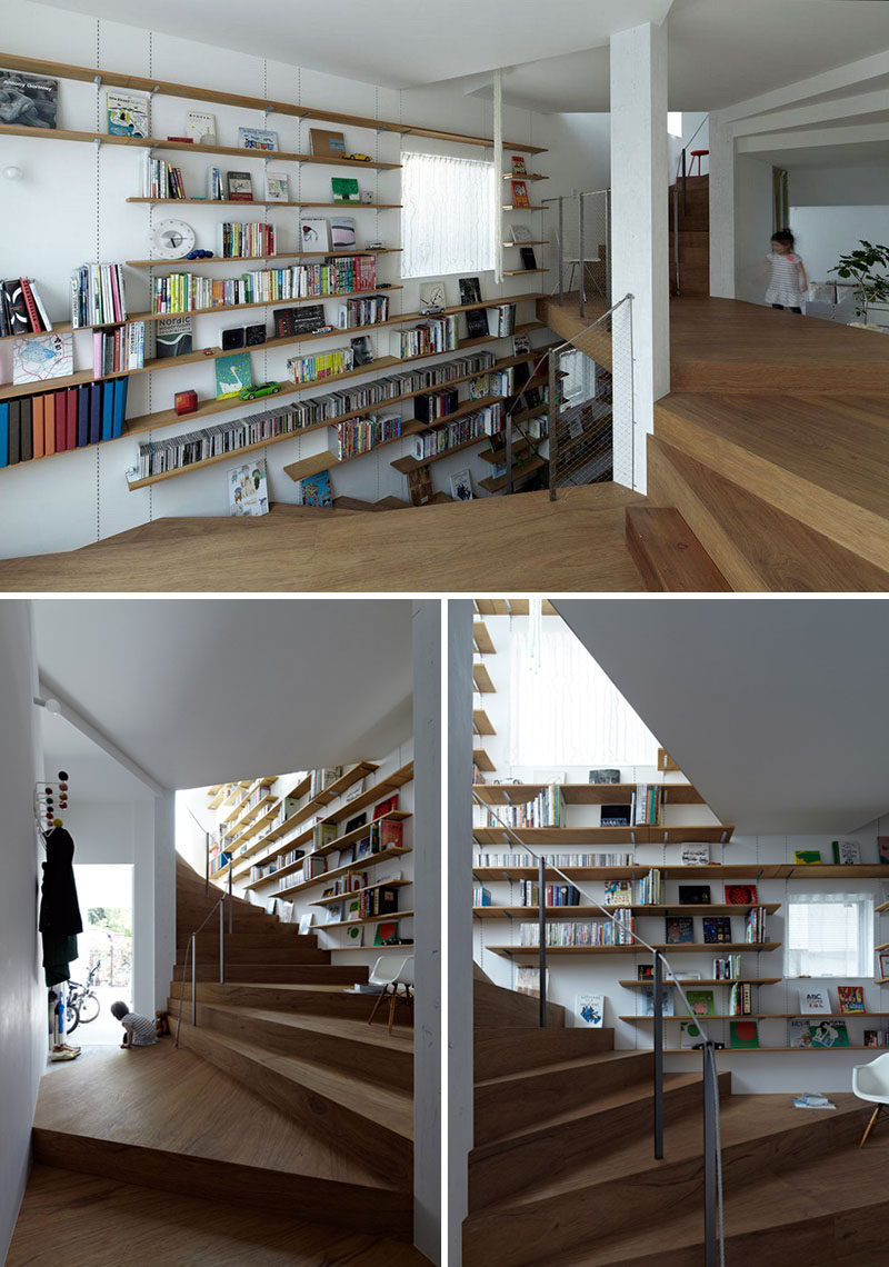 Stairs Design Ideas - 12 Examples Of Staircases With Bookshelves // This winding staircase has floating bookshelves along one side of it.