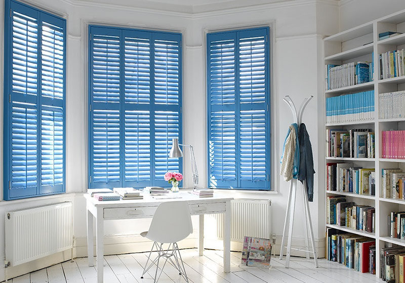 7 Contemporary Ideas For Window Coverings // Louvers are a combination of shutters and Venetian blinds. To allow maximum light in, they open like shutters. But when they're closed they have shades that can be tilted to allow varying degrees of light through them. While they're typically horizontal they can also be made vertically for a more unique and modern look.